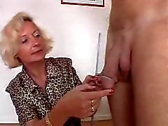 Italian Granny enjoys 2 cocks