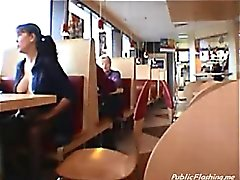 Dark haired girl flashing boobs in public restaurant