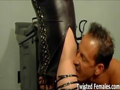 Two merciless dommes double team the new slave