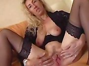 Nasty mature blonde spreads her pussy lips and stuffs in a dildo