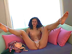 Bushy brunette hair widen her legs on the webcam