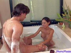 Lovely Asian Tia Ling gives jacuzzi Handjob