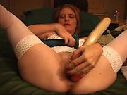 Gorgeous redhead loves anal masturbation