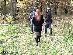 Busty redhead blowjob in a park