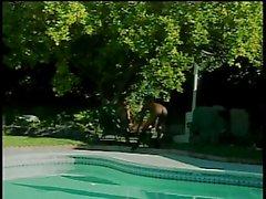 Dirty ebony duo pussy lick wildly near pool