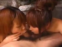 Asian cuties in a pool take turns sucking and titty fucking