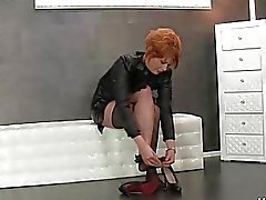 Sexy Redhead Pulls On Her Stockings