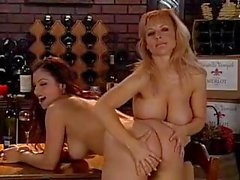Danni Ashe and Aria Giovanni are two hot busty babes going lesbian