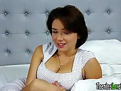 Busty babe rubs big tits