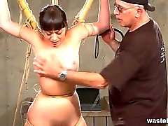 Older master ties and flogs Oriental slave