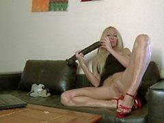 Lovely MILF blonde Tamara Dix doing a strip on her webcam