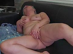 Solo grandma masturbates and caresses her mounds