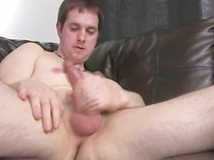 Young amateur stroking his oiled-up cock