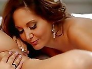 Busty MILF Ava Addams Eats A Young Babe Out