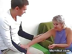 Russian Mother With A Young Guy