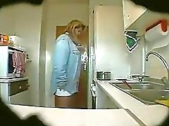 spy footage mature Erika in the kitchen