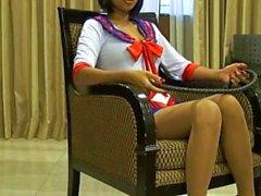 Atractiva de tailandesa modelo Xanny posa en pantimedias y se sexy traje