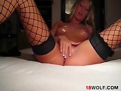 Teen In Fishnets Masturbates With A Dildo