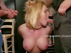 Blondie with hot ass and big boobs helds by men in cinema with hands behind in front of public sex