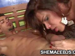 Latina shemale Hilda Brasil giving her man a blowjob