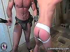 Kinky BDSM gay scene with spanking