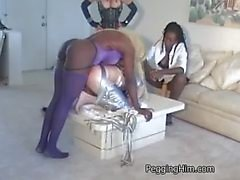 Two muscular Mistresses fuck a smaller guy in the ass with strapon