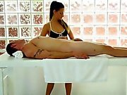 Tight masseuse blowjobs her clients cock under the table