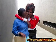 Ebony babes share passionate kisses in bathroom