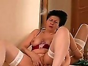 Granny In Lingerie Strips And Rubs Pussy