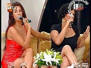 Upskirt and Downblouse Turkish singer Tuba Ekinci