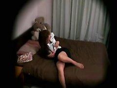 Lussuriosi Babe dell'Asia Orientale si diffonde il suo corpo sul letto e la km
