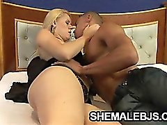 Blonde latina shemale Mel Voguel shows off her body before