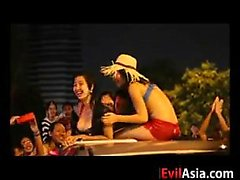 Asian Girls Stripping At A Festival