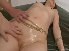 Horny guys oil up Riko&#039_s shaved pussy and finger it