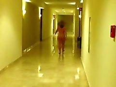 Nude in hotel hallway. Short vid.