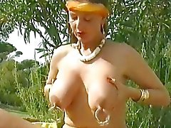 German girl plays with her large pierced nipples
