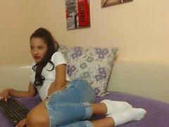 Teen Latin brunette enjoys sexy chat masturbation