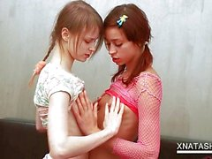 Delicate lesbo teens strip naked and make out