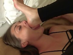 Brunette dominates with bedroom footworship