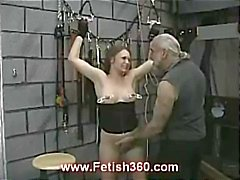 Brunette Joleen gets nipple punished and whipped as she's tied up