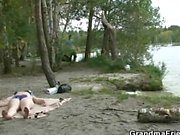 Two dudes bang oldie near lake