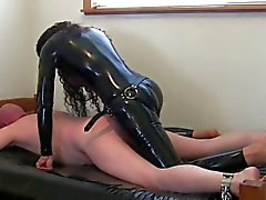 kinky brunette in latex fucks dude