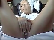 Woman gets horny after a shower and masturbates where she t