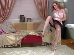 Lovelye Katie Collins in nylons takes off her skirt