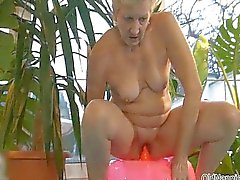 Dirty old woman masturbates her cunt