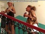 Lesbians prepare dildos for sex session