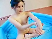 Skinny tight ass Asian teen fingers her wet pussy