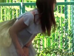 Asian teen peeing outside