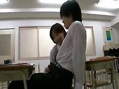 Sexy teacher indulges in some dick-rubbing with her hot stu