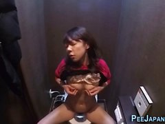 Asian babe rubs and pees